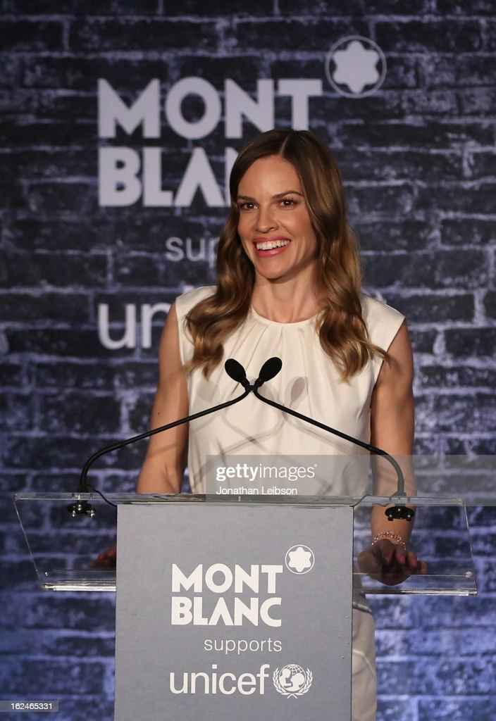 Hilary Swank wearing Montblanc Collection Princesse Grace de Monaco in Red Gold and diamonds speaks at a Pre-Oscar charity brunch hosted by Montblanc and UNICEF to celebrate the launch of their new 'Signature For Good 2013' Initiative with special guest Hilary Swank at Hotel Bel-Air on February 23, 2013 in Los Angeles, California.