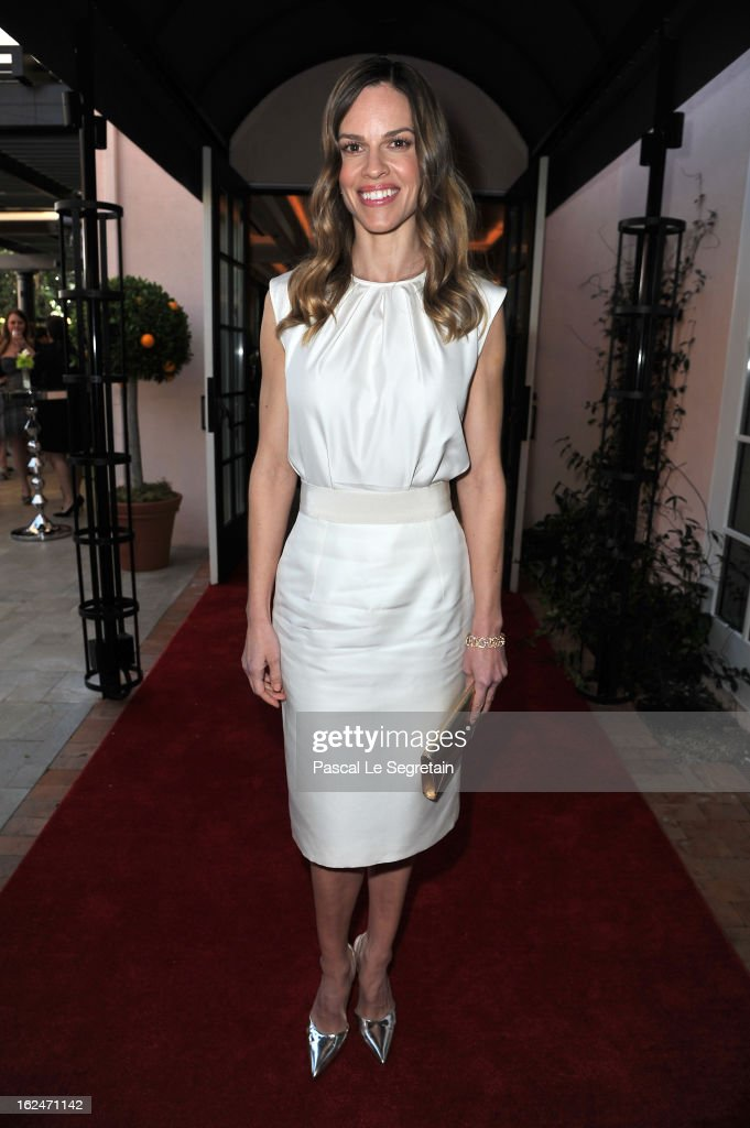 Hilary Swank wearing Montblanc Collection Princesse Grace de Monaco in Red Gold and diamonds attends a Pre-Oscar charity brunch hosted by Montblanc and UNICEF to celebrate the launch of their new 'Signature For Good 2013' Initiative with special guest Hilary Swank at Hotel Bel-Air on February 23, 2013 in Los Angeles, California.