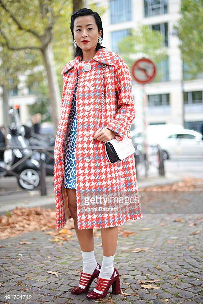 Hilary Tsui poses wearing Miu Miu before the Miu Miu show at the Palais de Iena during Paris Fashion Week SS16 on October 7 2015 in Paris France