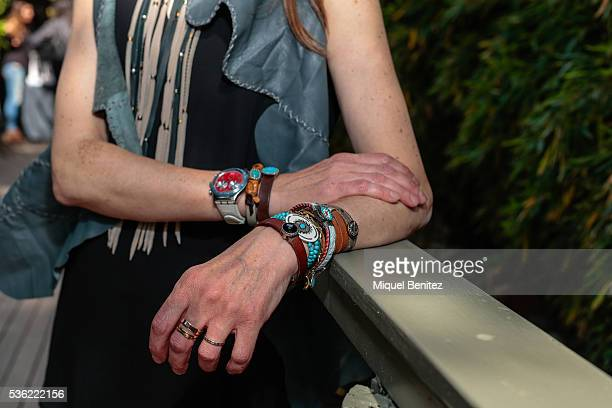 Hilda is wearing a Vass Handmede Vest and bracelets Zara blouse Meltin Pot jeans Panam Kack sandals a a Swatch watch at the Market Outlet Los Tilos...