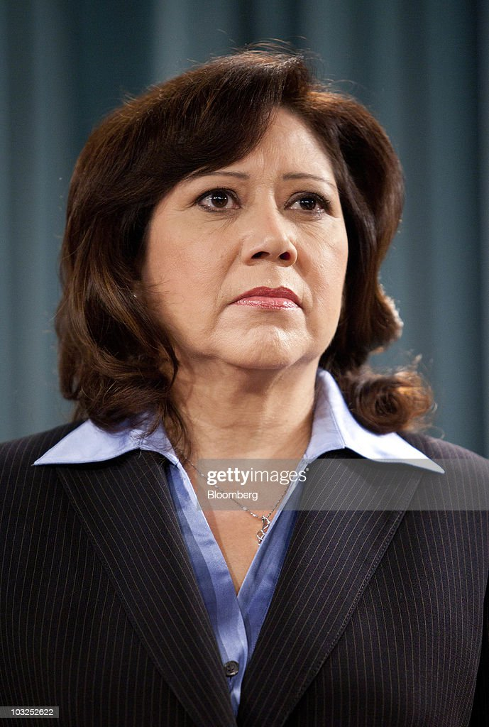 Hilda Solis trustee and US secretary of labor listens during a news conference in Washington DC US on Thursday Aug 5 2010 Medicare will gain an extra...