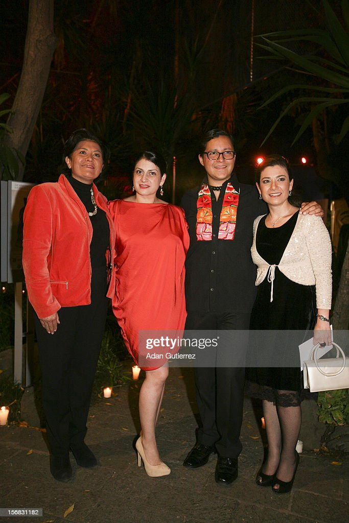 Hilda Trujillo (L) and Circe Henestrosa (2L) pose for a photo during the presentation of the exhibition Las Apariencias Engañan: The Frida Kahlo Dresses presented by Vogue magazine at Frida Kahlo´s museum on November 21, 2012 in Mexico City, Mexico.