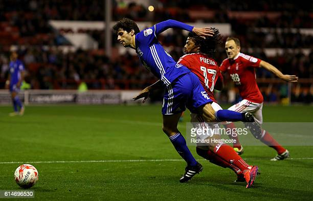 Hildeberto Pereira of Forest brings down Diego Fabbrini of Birmingham during the Sky Bet Championship match between Nottingham Forest and Birmingham...