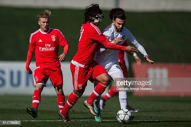 Hildeberto Pereira of SL Benfica competes for the ball with Borja Mayoral of Real Madrid CF during the UEFA Youth League Quarter Finals match between...