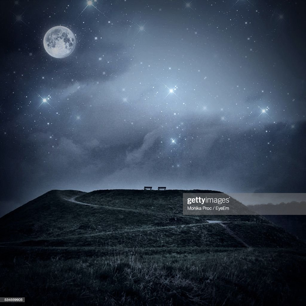 Hill Against Star Field With Moon At Night Stock Photo ...