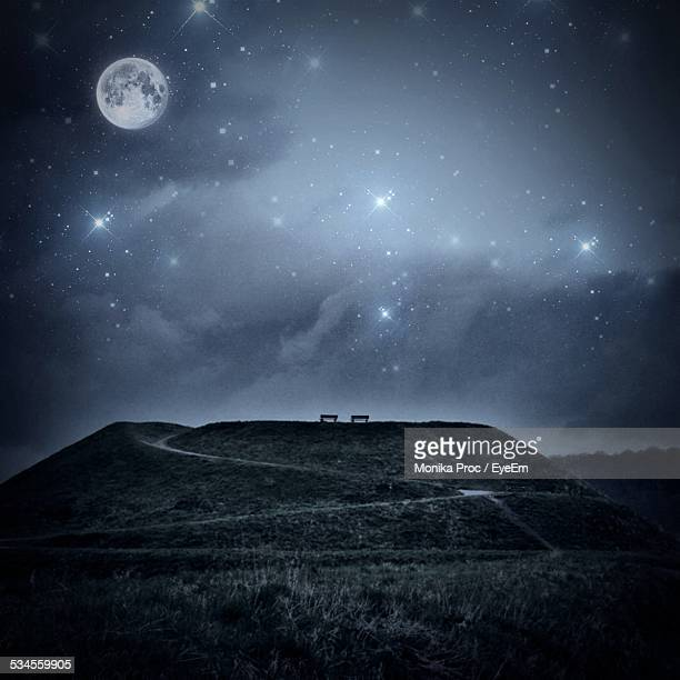 Hill Against Star Field With Moon At Night