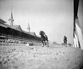 Hill Gail in the great tradition of the Calumet Farm crosses the finish line for a thrilling victory in the 78th running of the Kentucky Derby held...
