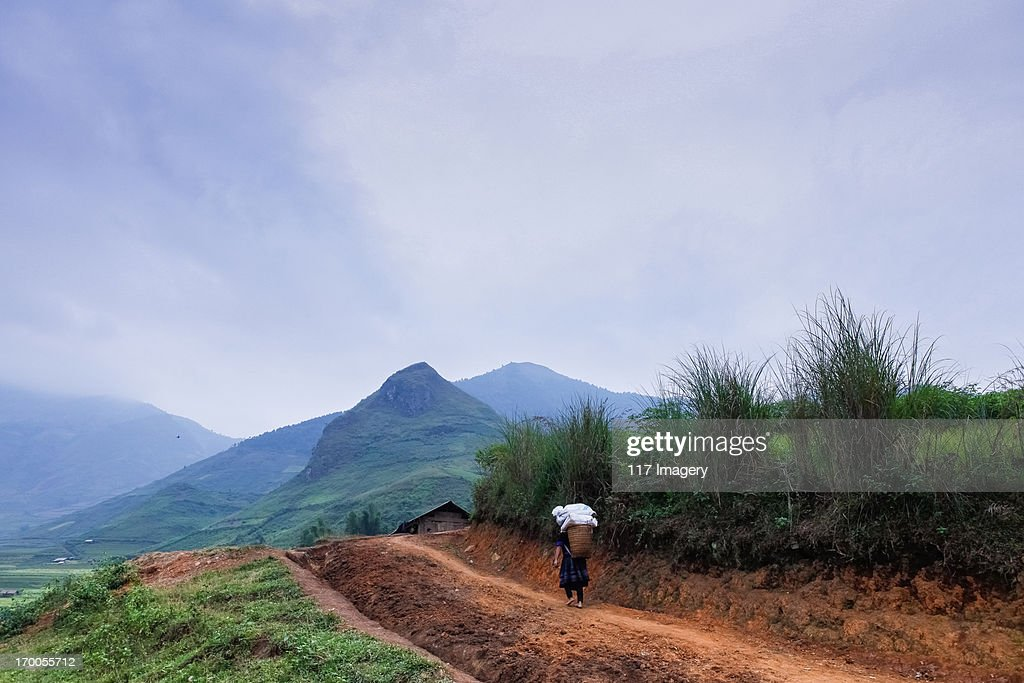 A hill tribe woman walking home