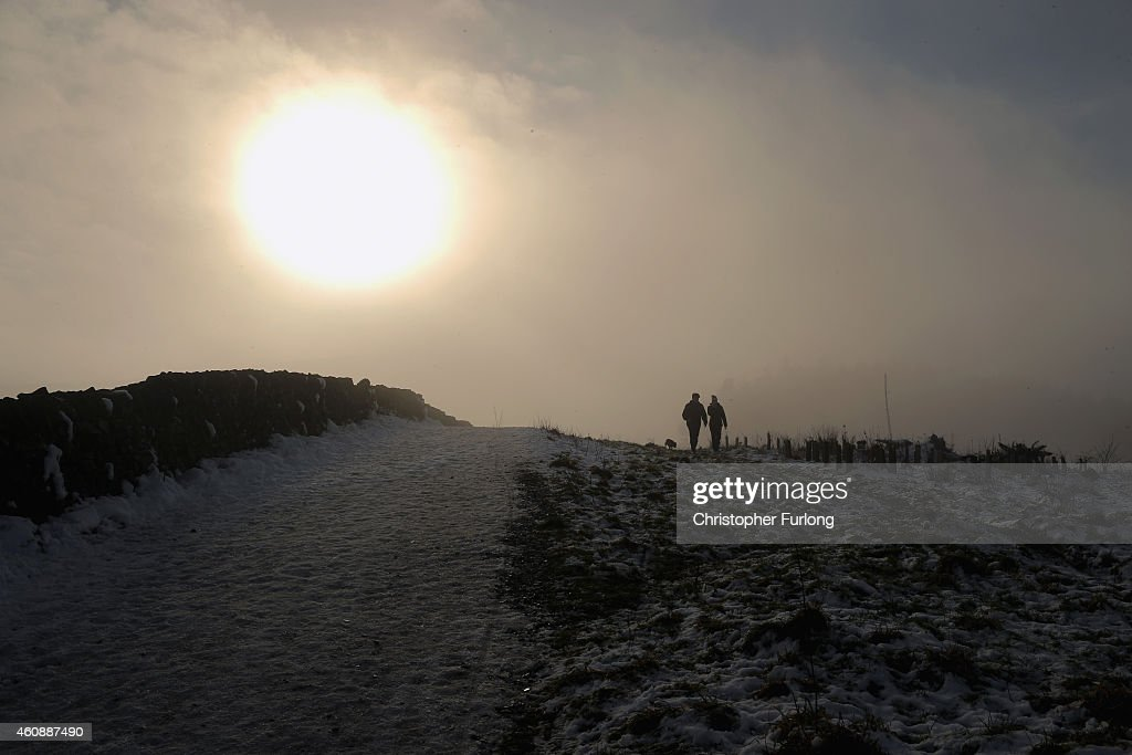 Hill walkers enjoy the a ramble in freezing fog on the hilltops in the High Peak near Macclesfield on December 29, 2014 in Macclesfield, United Kingdom. According to the Met Office Britain experienced the coldest night of the year overnight, with some areas being even colder than Alaska and the Antarctica and as forecasters believe it could get even colder tonight, a Met Office cold weather alert for northern England and the Midlands has warned of health risks for vulnerable people.