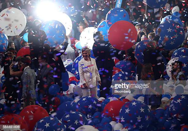 Hillary Clinton 2016 Democratic presidential nominee center stand as balloons and confetti fall on stage during the Democratic National Convention in...