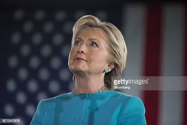 Hillary Clinton 2016 Democratic presidential nominee listens on stage during a campaign rally in Manchester New Hampshire US on Sunday Nov 6 2016...