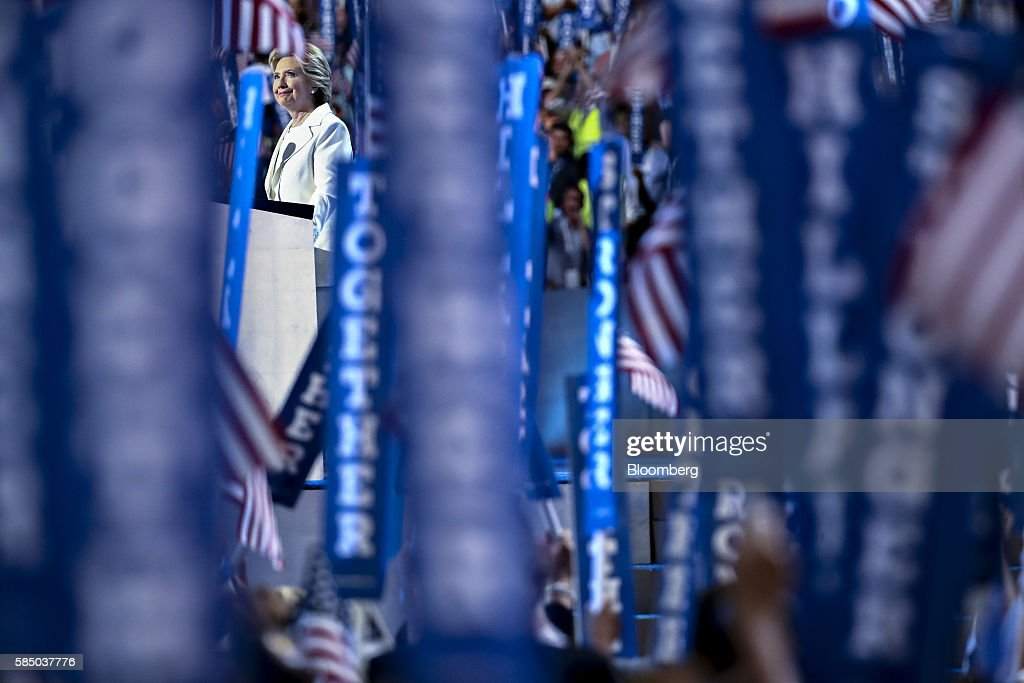 Hillary Clinton, 2016 Democratic presidential nominee, pauses while speaking during the Democratic National Convention (DNC) in Philadelphia, Pennsylvania, U.S., on Thursday, July 28, 2016. Division among Democrats has been overcome through speeches from two presidents, another first lady and a vice-president, who raised the stakes for their candidate by warning that her opponent posed an unprecedented threat to American diplomacy. Photographer: Andrew Harrer/Bloomberg via Getty Images