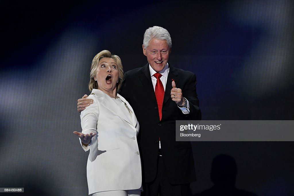 Hillary Clinton, 2016 Democratic presidential nominee, reacts on stage with her husband Bill Clinton during the Democratic National Convention (DNC) in Philadelphia, Pennsylvania, U.S., on Thursday, July 28, 2016. Division among Democrats has been overcome through speeches from two presidents, another first lady and a vice-president, who raised the stakes for their candidate by warning that her opponent posed an unprecedented threat to American diplomacy. Photographer: David Paul Morris/Bloomberg via Getty Images