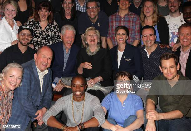 Hillary Clinton and Bill Clinton pose with the cast backstage at the hit musical 'Come From Away' on Broadway at The Schoenfeld Theatre on June 15...