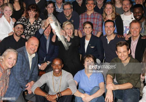 Hillary Clinton Bill Clinton and Chelsea Clinton pose with the cast backstage at the hit musical 'Come From Away' on Broadway at The Schoenfeld...
