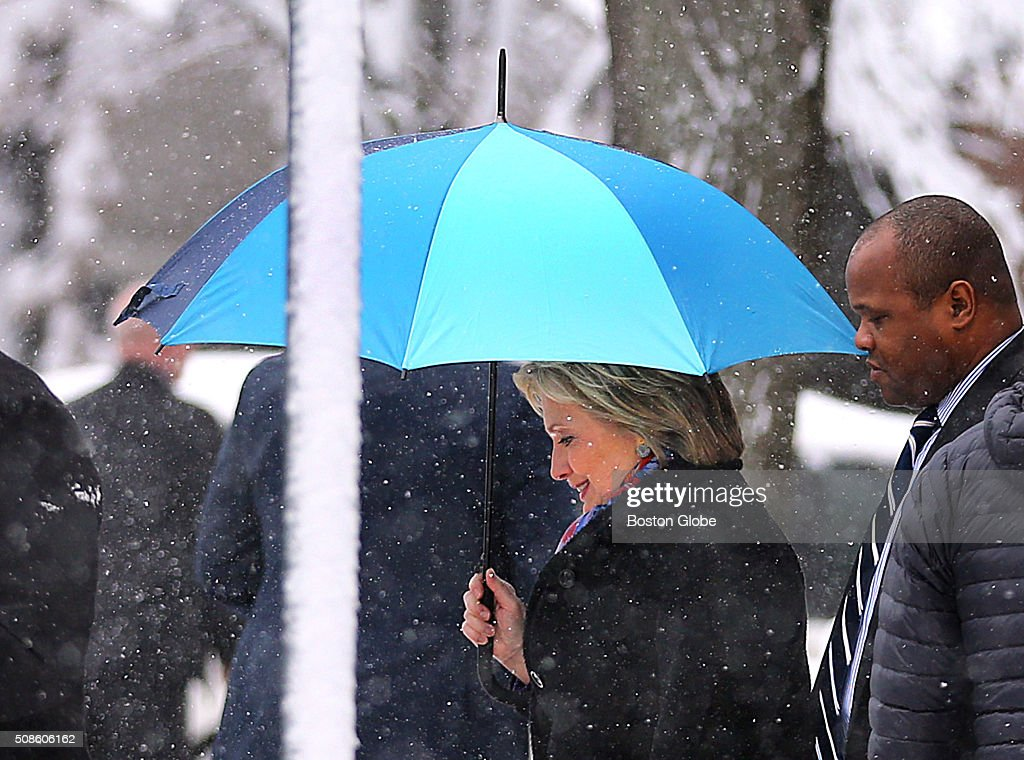 Hillary Clinton campaigned at the Manchester Canvass Kick-Off with Women Leaders at the YMCA in Manchester, N.H., Feb. 5, 2016. She left holding an umbrella in the snow.