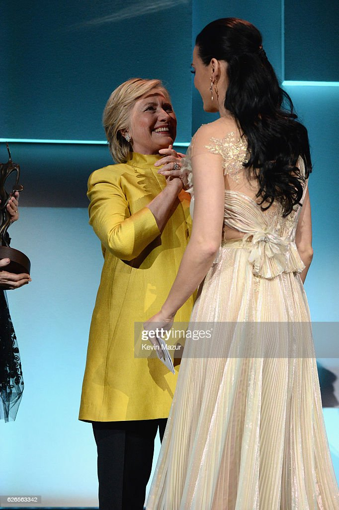 Hillary Clinton congratulates Katy Perry on stage during the 12th annual UNICEF Snowflake Ball at Cipriani Wall Street on November 29, 2016 in New York City.