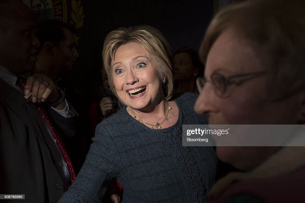 Hillary Clinton, former Secretary of State and 2016 Democratic presidential candidate, center, greets attendees during a campaign event in Concord, New Hampshire, U.S., on Saturday, Feb. 6, 2016. Trailing Bernie Sanders in the Democratic contest by 20 percentage points or more in some polls of voters in the state, Clinton recalled that New Hampshire gave her a come-from-behind victory in the 2008 primary race and a dramatic boost to her husband, Bill Clinton, in his first run for the presidency in 1992. Photographer: Daniel Acker/Bloomberg via Getty Images