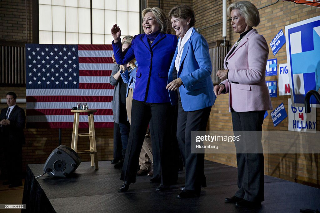 Hillary Clinton, former Secretary of State and 2016 Democratic presidential candidate, center, laughs while on stage with Senator Jeanne Shaheen, a Democrat from New Hampshire, center right, after speaking during a campaign rally with Lilly Ledbetter, women's equality activist, right, at a YWCA in Manchester, New Hampshire, U.S., on Friday, Feb. 5, 2016. Democratic Party officials in Iowa say they can't do a recount of Monday's razor-thin presidential caucus results between Clinton and Senator Bernie Sanders, even if they thought it was appropriate. And both candidates, in their debate later Thursday night, said it was no big deal. Photographer: Andrew Harrer/Bloomberg via Getty Images