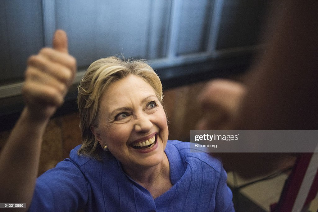 <a gi-track='captionPersonalityLinkClicked' href=/galleries/search?phrase=Hillary+Clinton&family=editorial&specificpeople=76480 ng-click='$event.stopPropagation()'>Hillary Clinton</a>, former Secretary of State and presumptive Democratic presidential nominee, greets attendees after speaking at a campaign event in Cincinnati, Ohio, U.S., on Monday, June 27, 2016. Clinton released a new national television ad on Sunday attacking likely Republican rival Donald Trump for his comments on the U.K's decision to leave the European Union, and later warned of the negative impact that 'bombastic' behavior can have at times of crisis. Photographer: Ty Wright/Bloomberg via Getty Images