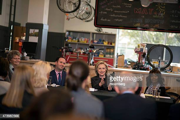 Hillary Clinton former secretary of state and US presidential candidate second from right speaks during a small business roundtable discussion with...