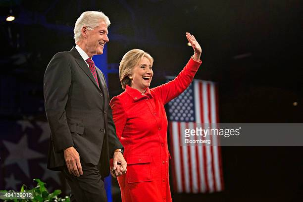 Hillary Clinton former US secretary of state and 2016 Democratic presidential candidate right stands on stage with husband Bill Clinton former US...