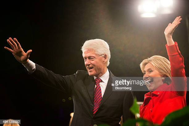 Hillary Clinton former US secretary of state and 2016 Democratic presidential candidate right waves to supporters with husband Bill Clinton former US...