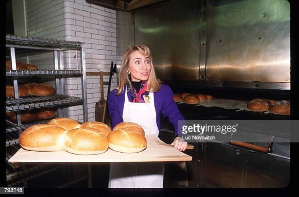 Hillary Clinton handles bread April 3 1992 in New York City Clinton campaigns for her husband with four days remaining until New York's primary...