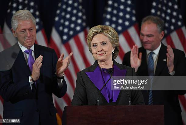 Hillary Clinton is joined on stage by her husband Bill Clinton and her running mate Tim Kaine as she speaks during a press conference at the Wyndham...