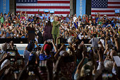 Hillary Clinton presumptive 2016 Democratic presidential nominee applauds while arriving on stage during a campaign event in Tampa Florida US on...