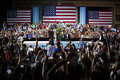 Hillary Clinton presumptive 2016 Democratic presidential nominee gestures while arriving on stage during a campaign event in Tampa Florida US on...