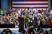 Hillary Clinton presumptive 2016 Democratic presidential nominee gestures while speaking during a campaign event in Tampa Florida US on Friday July...