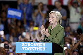 Hillary Clinton presumptive 2016 Democratic presidential nominee applauds while speaking during a campaign event in Tampa Florida US on Friday July...