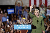 Hillary Clinton presumptive 2016 Democratic presidential nominee waves after speaking during a campaign event in Tampa Florida US on Friday July 22...