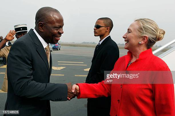 Hillary Clinton shakes hands with Togo Prime Minister Gilbert Houngbo after arriving in Lome Togo on January 17 2012 US Secretary of State Hillary...