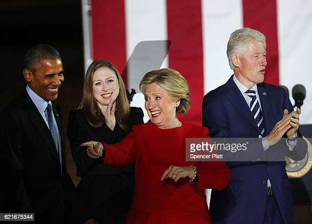 Hillary Clinton stands with President Barack Obama former President Bill Clinton and daughter Chelsea during an election eve rally on November 7 2016...
