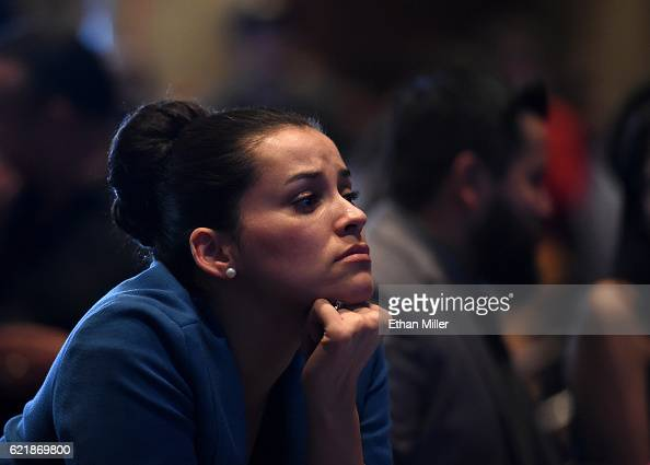 Hillary Clinton supporter Celinda Pena reacts as she watches the presidential election swing in favor of Donald Trump at the Nevada Democratic...