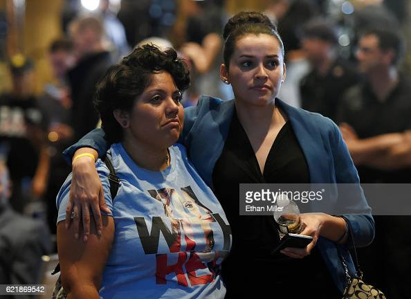 Hillary Clinton supporters Susan Taylor and Celinda Pena react as they watch the presidential election swing in favor of Donald Trump at the Nevada...