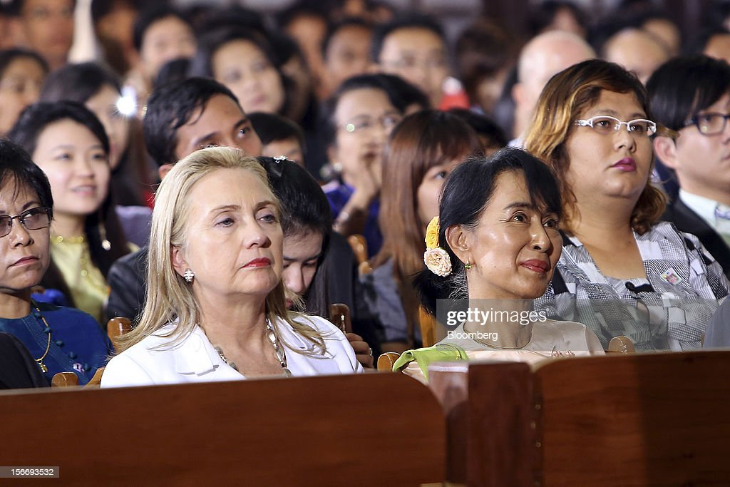 Hillary Clinton, U.S. secretary of state, left, and Aung San Suu Kyi, Myanmar's opposition leader, listens as U.S. President Barack Obama address the audience during his speech at the University of Yangon in Yangon, Myanmar, on Monday, Nov. 19, 2012. Obama hailed Myanmar's shift to democracy and urged more steps to increase freedom in the first visit to the former military regime by a U.S. president. Photographer: Dario Pignatelli/Bloomberg via Getty Images