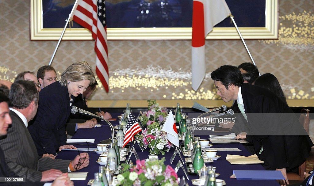 Hillary Clinton, U.S. secretary of state, left, and Katsuya Okada, Japan's foreign minister, take their seats during their meeting at the Iikura Guest House in Tokyo, Japan, on Friday, May 21, 2010. Clinton arrived in Asia today for talks with China and U.S. allies now focused on how to manage a crisis over suspected North Korean involvement in the sinking of a South Korean warship. Photographer: Itsuo Inouye/Pool via Bloomberg