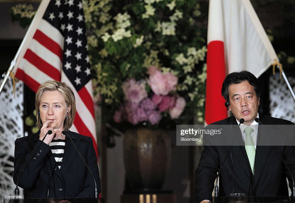 Hillary Clinton, U.S. secretary of state, left, listens to Katsuya Okada, Japan's foreign minister, during their joint news conference at the Iikura Guest House in Tokyo, Japan, on Friday, May 21, 2010. Clinton said North Korea's sinking of a South Korean warship' cannot go unanswered' and the response by the international community must not be 'business as usual.' Photographer: Itsuo Inouye/Pool via Bloomberg