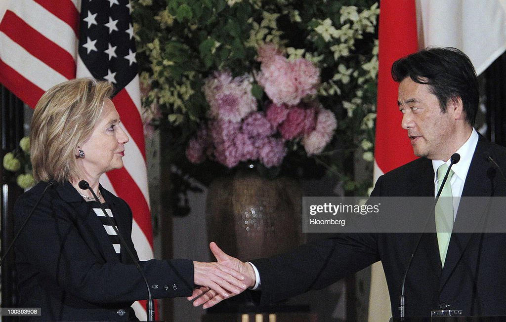 Hillary Clinton, U.S. secretary of state, left, shakes hands with Katsuya Okada, Japan's foreign minister, during their joint news conference at the Iikura Guest House in Tokyo, Japan, on Friday, May 21, 2010. Clinton said North Korea's sinking of a South Korean warship' cannot go unanswered' and the response by the international community must not be 'business as usual.' Photographer: Itsuo Inouye/Pool via Bloomberg