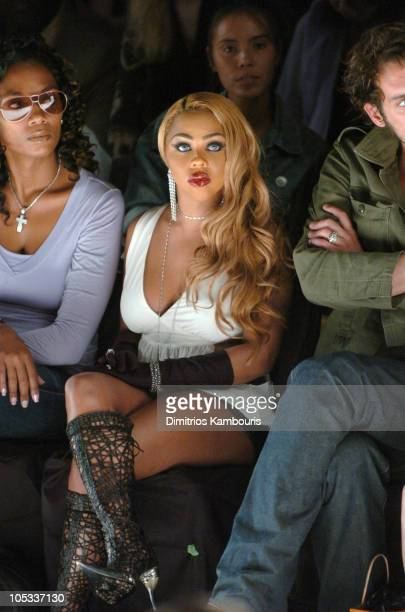 Hillary Cooper and Lil Kim during Olympus Fashion Week Spring 2005 Jeremy Scott Front Row and Backstage at Bryant Park in New York City New York...