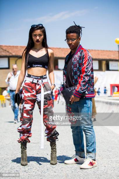 Hillary Jocson Gianne and Michael Lopez in Gucci total look are seen during Pitti Immagine Uomo 92 at Fortezza Da Basso on June 15 2017 in Florence...