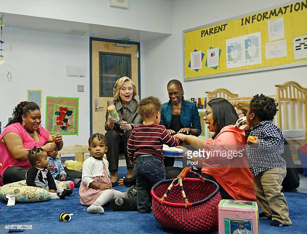 Hillary Rodham Clinton center rear and New York City first lady Chirlane McCray play music with children in a classroom at FirstStepNYC an early...