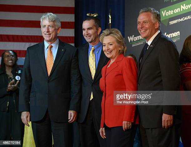 Hillary Rodham Clinton center right in red stands with the Democratic ticket as she endorses Virginia gubernatorial candidate Terry McAuliffe far...