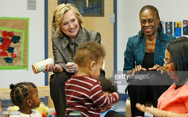 Hillary Rodham Clinton left and New York City first lady Chirlane McCray visit a classroom for children seven to 18 months at FirstStepNYC an early...