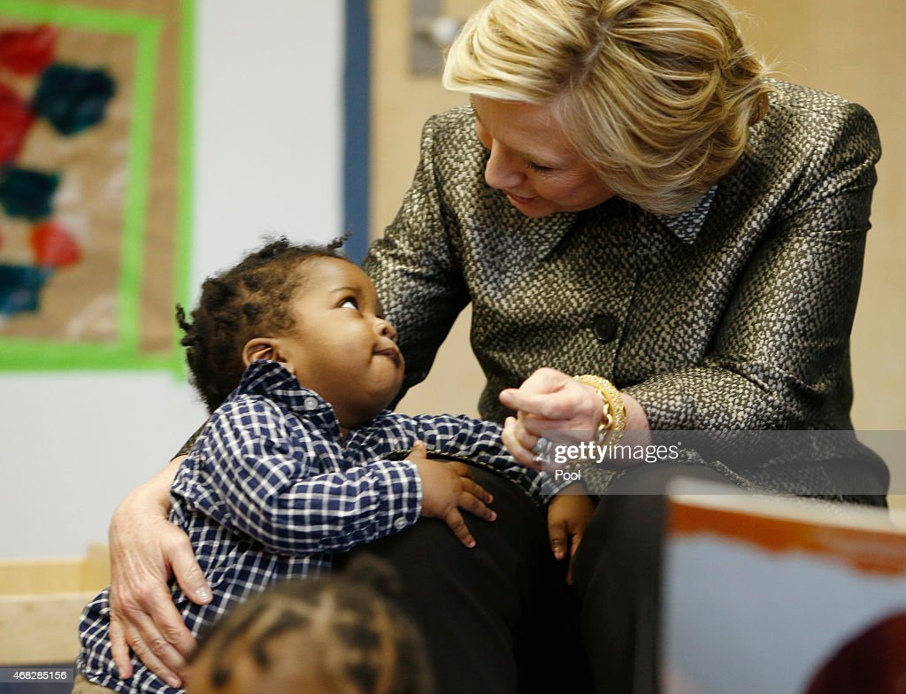 Hillary Rodham Clinton talks to a youngster during a visit to an early childhood development center on April 1, 2015 in the Brooklyn borough of New York City. Clinton and McCray are teaming up with New York's deputy mayor launching and program to encourage parents to talk to their children to help with early childhood development.