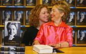 Hillary Rodham Clinton talks with her daughter Chelsea Clinton as she signs copies of her autobiography 'Living History' July 5 2003 in Oxford...