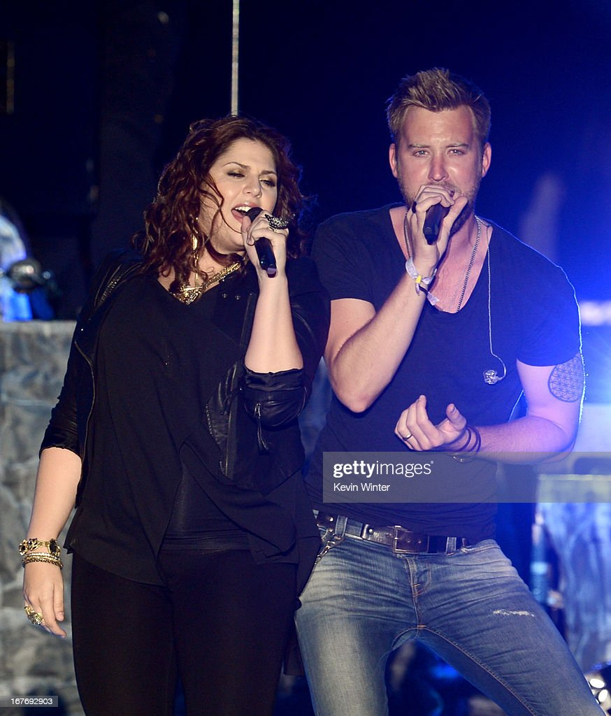 Hillary Scott and <a gi-track='captionPersonalityLinkClicked' href=/galleries/search?phrase=Charles+Kelley&family=editorial&specificpeople=3935435 ng-click='$event.stopPropagation()'>Charles Kelley</a> of Lady Antebellum perform onstage during 2013 Stagecoach: California's Country Music Festival held at The Empire Polo Club on April 27, 2013 in Indio, California.